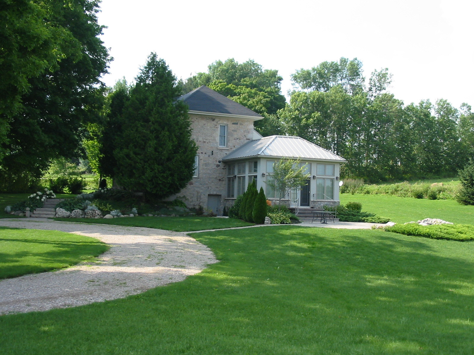 Patio for old stone farmhouse near Belwood