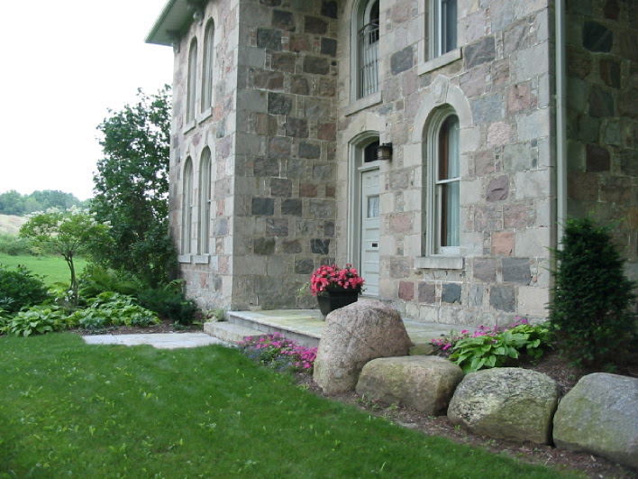 Formal entrance with modernized stone porch