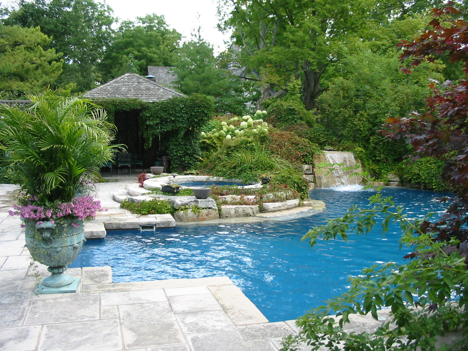 Swimming pool with curved stone steps