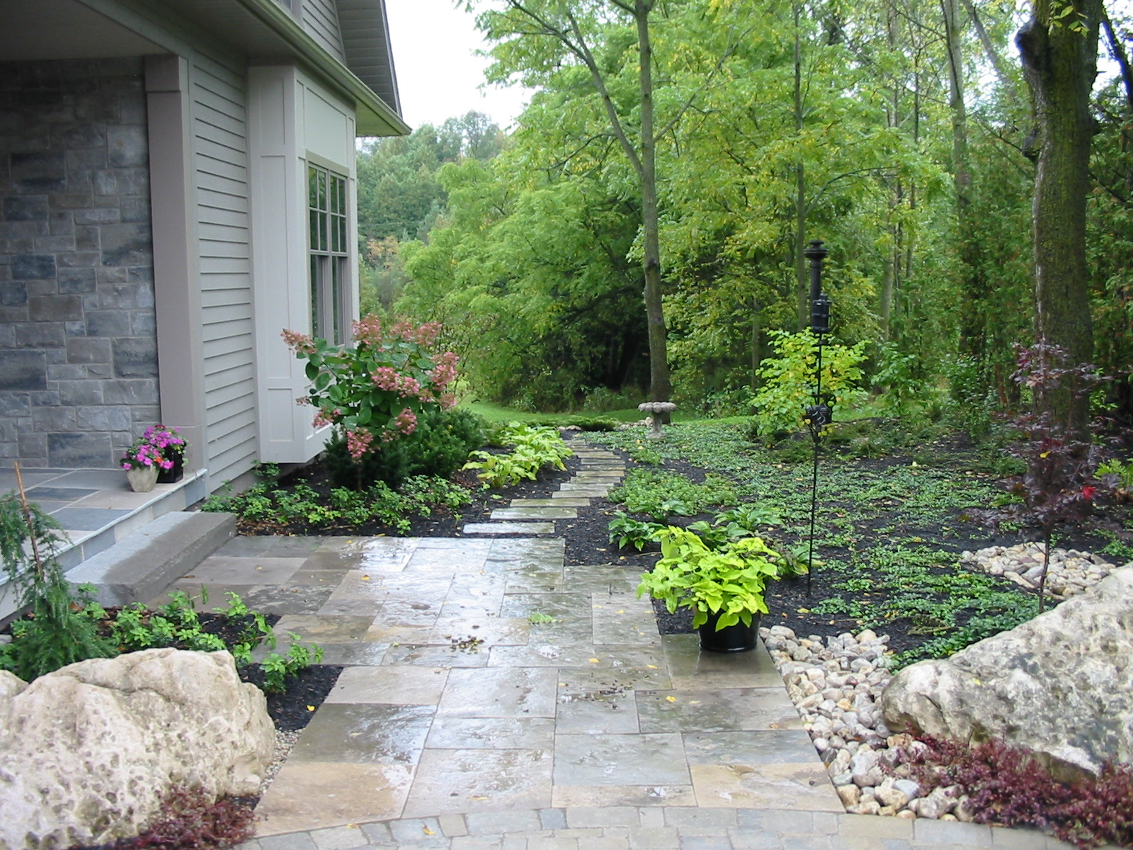 Natural Images Landscaping A natural stone pathway with